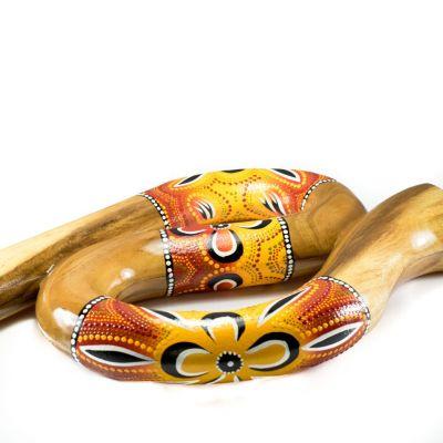 Cestovné didgeridoo esovitého tvaru v červeno-žltom prevedení